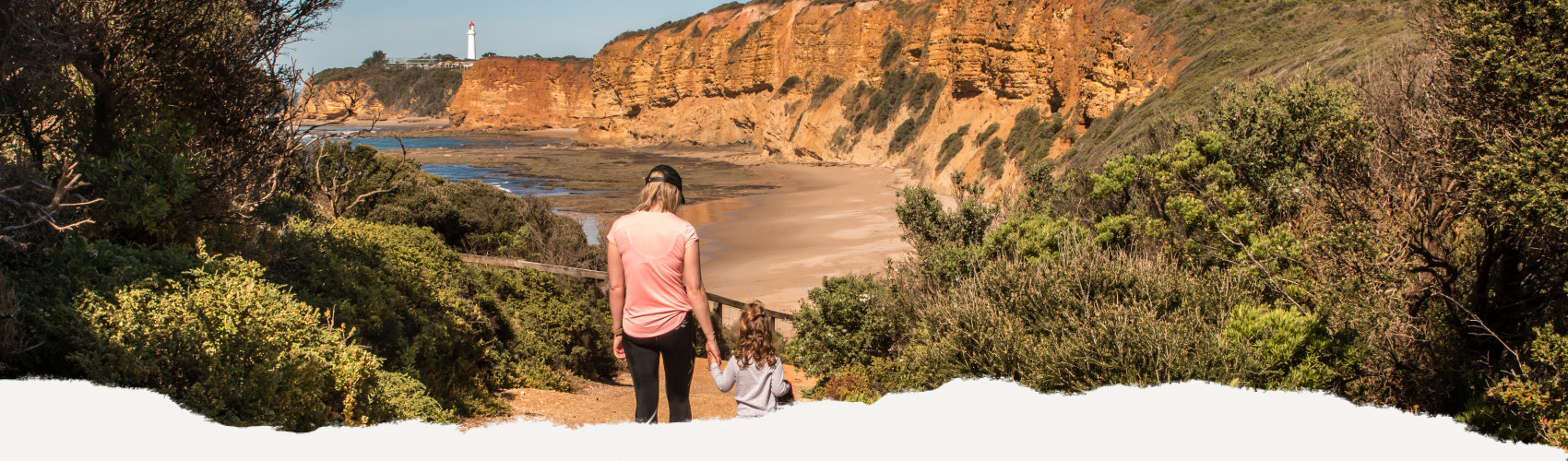 Mother and child walking along the track to Aireys Lighthouse