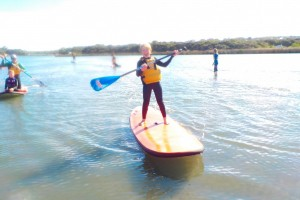 Kids learning to SUP on the Anglesea River