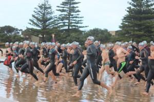 Running into water for Danger 1000 Ocean Swim