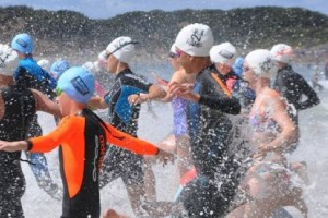 Swimmers running into water for Rock 2 Ramp Swim